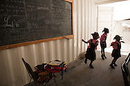 CLIENT: UNICEF<br /> <br /> Students dance during a class being held in a mobile classroom at the Saint Gerard School in Port-au-Prince, Haiti.  The school was heavily damaged in the January 12 quake.