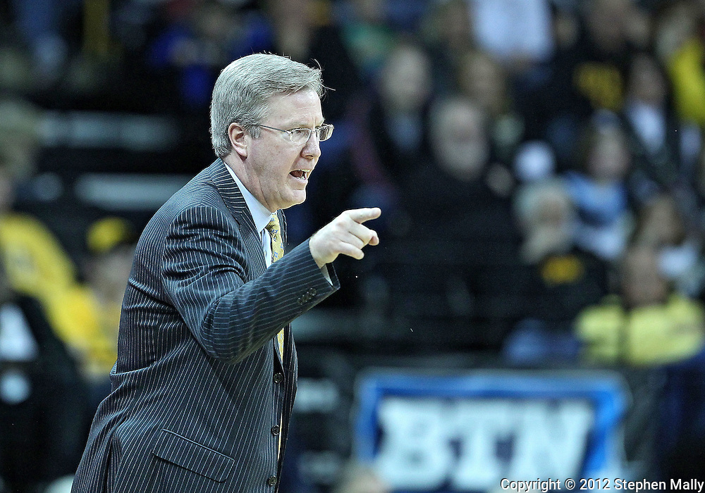 January 07, 2011: Iowa Hawkeyes head coach Fran McCaffery yells at the officials during the the NCAA basketball game between the Ohio State Buckeyes and the Iowa Hawkeyes at Carver-Hawkeye Arena in Iowa City, Iowa on Saturday, January 7, 2012.