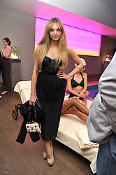 ZARA MARTIN at a pool party to celebrate the UK launch of the Omega Ladymatic Collection held at the Haymarket Hotel, Haymarket, London on 16th June 2011.
