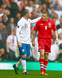 26.03.2011, Millenium Stadium, Cardiff, ENG, EURO 2012 Qualifikation, England vs Wales, im Bild Graig Bellamy  of Wales  clashes with Wayne Rooney of England    during Wales vs England at the Millenium Stadium in Cardiff for the Euro 2012 qualification, group G  on 26/03/2011. EXPA Pictures © 2011, PhotoCredit: EXPA/ IPS/ Marcello Pozzetti +++++ ATTENTION - OUT OF ENGLAND/UK and FRANCE/FR +++++