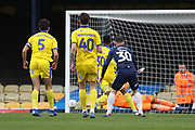 Shot from Southend United attacker Harry Bunn (30) just going wide and AFC Wimbledon goalkeeper Aaron Ramsdale (35) diving during the EFL Sky Bet League 1 match between Southend United and AFC Wimbledon at Roots Hall, Southend, England on 16 March 2019.