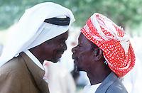 Men greet each other in Kuwait
