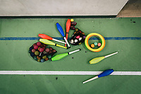 """NAPLES, ITALY - 16 MARCH 2018: Claves and balls used during the circus activity are seen here at """"Il Tappeto di Iqbal"""" (Iqbal's carpet), a non-profit cooperative in Barra, the estern district of Naples, Italy, on March 16th 2018.<br /> <br /> Il Tappeto di Iqbal (Iqbal's Carpet) is a non-profit cooperative founded in 2015 and Save The Children partner since 2015 that operates in the Naple's eastern neighborhood of Barra children in the arts of circus, theater and parkour. It was named after Iqbal Masih, a Pakistani boy who escaped from life as a child slave and became an activist against bonded labor in the 1990s.<br /> Barra, which is home to some 45,000 people, has the highest rate of school dropouts in the Italian region of Campania. Once a thriving industrial community, many of the factories were destroyed in a 1980 earthquake and never rebuilt. The resulting de-industrialization turned Barra into a poor, decaying neighborhood. There are no cinemas, theaters, parks or public spaces in Barra.<br /> The vast majority of children from poor families are faced with the choice of working in the black economy or joining the ranks of the organised crime.<br /> Recently, Save the Children Italy opened a number of educational and social spaces in Barra. The centers, known as Punti Luce, or points of light, aim to help local kids stay out of the ranks of the organised crime and have also become hubs for Iqbal's Carpet to work."""