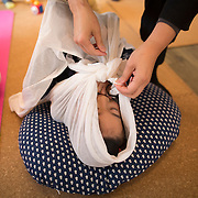 "TOKYO, JAPAN - JANUARY 29 : Naomi Ikeda, a midwife and a nurse wrapping a participant during a workshop called ""Otonamaki"", which directly translates to adult wrapping, in Tokyo, Japan on Sunday, January 29, 2017. Otonamaki is a Japanese therapeutic method meant to alleviate posture problems and stiffness. (Photo by Richard Atrero de Guzman/ANADOLU Agency)"