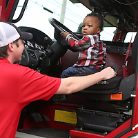 Lauren Wood | Buy at photos.djournal.com<br /> Austin Duck sits in the driver's seat of a fire truck as firefighter Jake Bennett and other firefighters from Tupelo Station No. 5 visit the Brown Bear Child Care and Learning Center Wednesday morning.