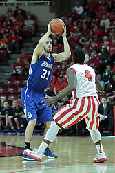 01 February 2014:  Aaron Hawley looks past Bobby Hunter during an NCAA Missouri Valley Conference (MVC) mens basketball game between the Drake Bulldogs and the Illinois State Redbirds  in Redbird Arena, Normal IL.