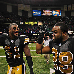 September 25, 2011; New Orleans, LA, USA; New Orleans Saints safety Roman Harper (41) and running back Mark Ingram (28) celebrate following a win over the Houston Texans at the Louisiana Superdome. The Saints defeated the Texans 40-33. Mandatory Credit: Derick E. Hingle