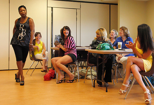Beaute Box Salon owner Lisa Scott practices her runway walk during meeting of celebrity models for the Dayton Fashion Week kickoff event, 'Fashion For A Cause' in the at SunWatch Indian Village/Archaeological Park in Dayton, Saturday, July 21, 2012.