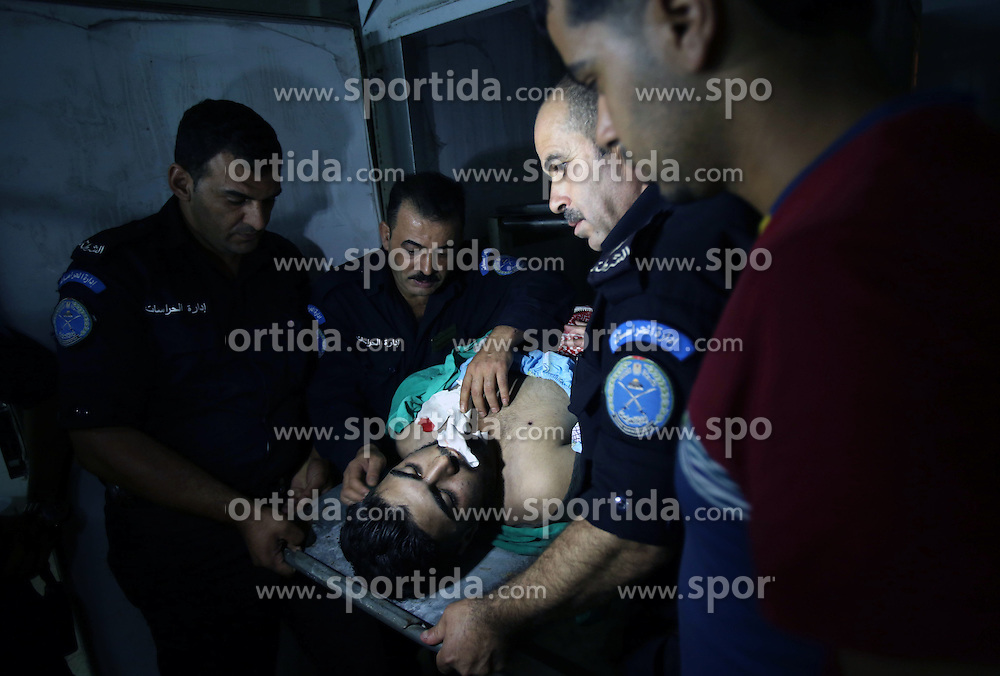 16.10.2015, Nablus, PSE, Gewalt zwischen Pal&auml;stinensern und Israelis, im Bild Zusammenst&ouml;sse zwischen Pal&auml;stinensischen Demonstranten und Israelischen Sicherheitskr&auml;fte // Palestinian policemen stand next to the body of 21-year-old Palestinian protester Ehab Hanani, who was shot by Israeli troops during clashes in Beit Forik village, at Rafeedia hospital, near the West Bank city of Nablus October 16, 2015. The unrest that has engulfed Jerusalem and the occupied West Bank, the most serious in years, has claimed the lives of 35 Palestinians and seven Israelis. The tension has been triggered in part by Palestinians' anger over what they see as increased Jewish encroachment on Jerusalem's al-Aqsa mosque compound, Palestine on 2015/10/16. EXPA Pictures &copy; 2015, PhotoCredit: EXPA/ APAimages/ Nedal Eshtayah<br /> <br /> *****ATTENTION - for AUT, GER, SUI, ITA, POL, CRO, SRB only*****