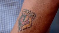 Photo: Daniel Hambury.<br />Crystal Palace v Watford. Coca Cola Championship. Play off Semi-Final, First Leg. 06/05/2006.<br />A Watford fan with his club badge tattooed on his arm.
