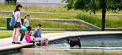 Pictured: Holly the dog was having fun in the water as owner Gail Middleton and friends enjoyed getting cooled down.<br /> <br /> <br /> <br /> Ger Harley | EEm date
