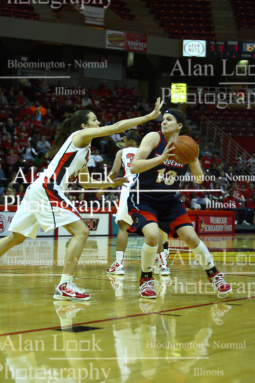 24 March 2011: Orsi Szecsi works the lane guarded by Hannah Spanich during a WNIT (Women's National Invitational Tournament Women's basketball sweet 16 game between the Duquesne Dukes and the Illinois State Redbirds at Redbird Arena in Normal Illinois.