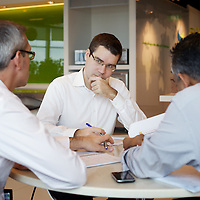 Staff meet in a Singapore office. <br />
