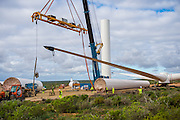 Crane Preparing to lift a section of the tower of a new wind turbine