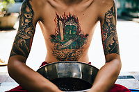 A young drug addict prepares for the ritual drinking and vomiting session at Tham Krabok temple in Saraburi, Thailand.
