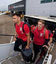 CARDIFF, WALES - Monday, September 4, 2017: Wales' Hal Robson-Kanu and David Edwards board the team plane as the squad depart Cardiff Airport to travel to Chișinău ahead of the 2018 FIFA World Cup Qualifying Group D match against Moldova. (Pic by David Rawcliffe/Propaganda)