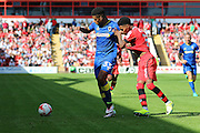 AFC Wimbledon striker Lyle Taylor (33) tussles with Walsall FC defender Rico Henry (3) during the EFL Sky Bet League 1 match between Walsall and AFC Wimbledon at the Banks's Stadium, Walsall, England on 6 August 2016. Photo by Stuart Butcher.