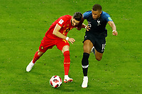 SAINT PETERSBURG, RUSSIA - JULY 10: Kylian Mbappe (R) of France national team and Yannick Carrasco of Belgium national team vie for the ball during the 2018 FIFA World Cup Russia Semi Final match between France and Belgium at Saint Petersburg Stadium on July 10, 2018 in Saint Petersburg, Russia. MB Media
