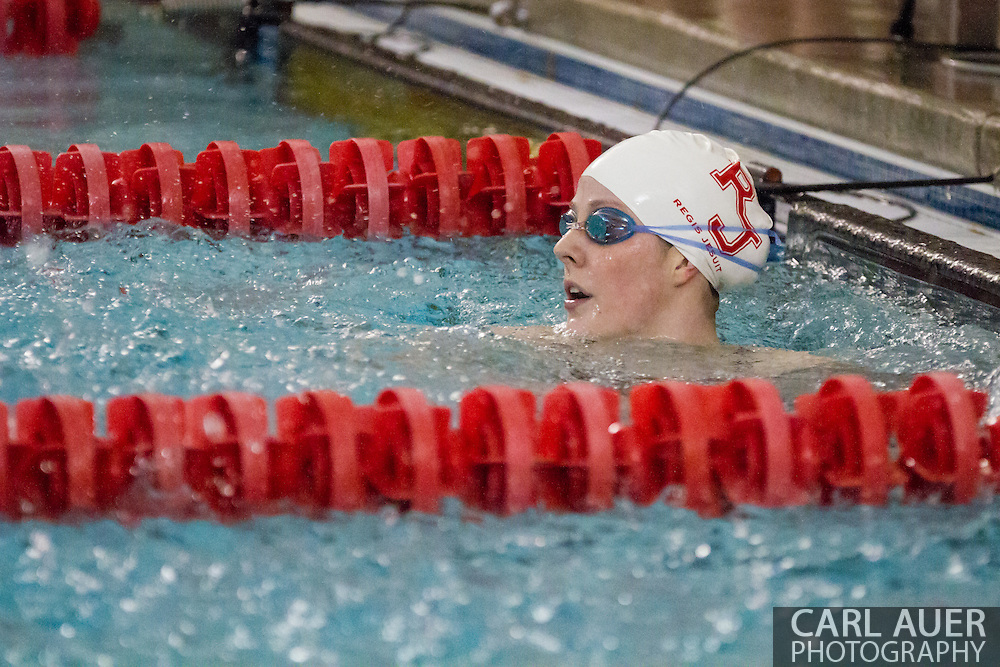 January 8, 2013: Olympic Gold Medalist and Regis Jesuit High School senior Missy Franklin watches her teammates in her return to the pool after the London Olympics during the swim meet against Highlands Ranch at Regis Jesuit High School.