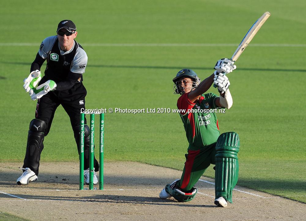 Mohammad Ashraful batting as Brendon McCullum looks on.<br />Cricket, KFC Twenty20 Match.<br />New Zealand Black Caps versus Bangladesh.<br />Seddon Park, Hamilton, New Zealand.<br />Tuesday 3 February 2010.<br />Photo: Andrew Cornaga/PHOTOSPORT