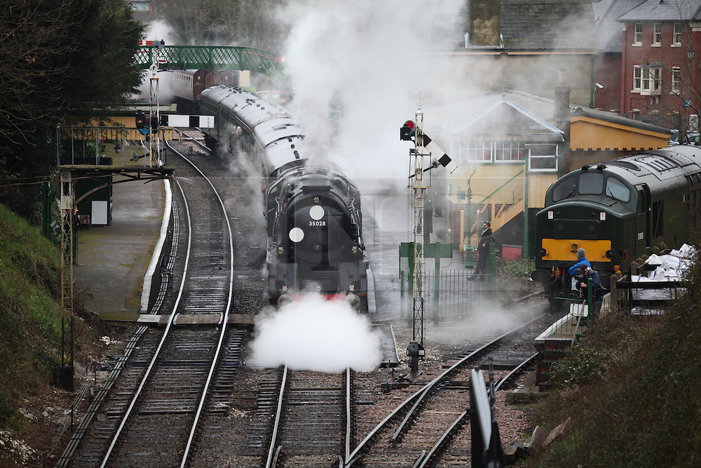 © Licensed to London News Pictures. 07/03/2014. Hampshire, UK. The steam locomotive '35028 - Clan Line', pulls out of Alresford Station today, 7th March 2014, which is the first day of the 'spring steam gala' on the Watercress Line. The railway line, operated by Mid Hants Railway Ltd, passes between Alresford and Alton in Hampshire. The line is named after its use in the past for transporting freshly cut watercress from the beds surrounding Alresford to London. Photo credit : Rob Arnold/LNP