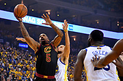 May 31, 2018; Oakland, CA, USA; Cleveland Cavaliers guard JR Smith (5) shoots the ball against Golden State Warriors guard Stephen Curry (30) during the first quarter in game one of the 2018 NBA Finals at Oracle Arena.