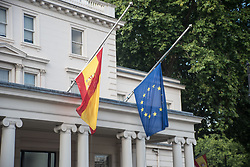 August 18, 2017 - London, England, United Kingdom - Flags fly at halfmast at Spanish Embassy in Central London, following the two terror attacks in Barcelona and Cambrils in Spain, London on August 18, 2017. A white van smashed into people on Las Ramblas on August 17, leaving 14 people killed and more than 100 injured. About eight hours later, an Audi A3 car ploughed into pedestrians in the popular seaside resort town of Cambrils, 110km (68 miles) south-west of Barcelona, authorities said. The Las Ramblas and Cambrils attacks are believed to be linked. (Credit Image: © Alberto Pezzali/NurPhoto via ZUMA Press)