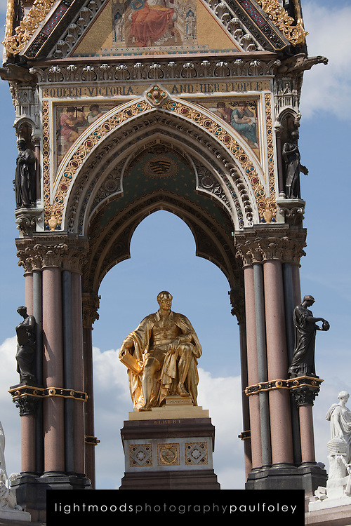"""The Albert Memorial, Kensington Gardens, London, England, north of the Royal Albert Hall. Commissioned by Queen Victoria in memory of her beloved husband, Prince Albert who died of typhoid in 1861. Designed by Sir George Gilbert Scott in the Gothic revival style. Opened in 1872, with the statue of Albert ceremonially """"seated"""" in 1875, the memorial consists of an ornate canopy or pavilion containing a statue of Prince Albert facing south. The memorial is 176 feet tall, took over ten years to complete, and cost £120,000."""