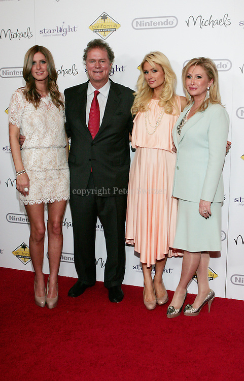 """Paris and Nicky Hilton arrive with Mom and Dad on the red carpet at """"A Stellar Night"""" hosted by """"Starlight Children's Foundation"""" who are brightening the lives of seriously and terminally ill children in order to take their minds off the pain, fear and isolation of their illness. The Gala benefit was held at the Century Plaza Hyatt Hotel in Century City Ca. Saturday March 26, 2011. Photo by Peter Switzer"""