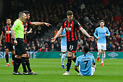 Chris Mepham (33) of AFC Bournemouth has words with Raheem Sterling (7) of Manchester City during the Premier League match between Bournemouth and Manchester City at the Vitality Stadium, Bournemouth, England on 2 March 2019.