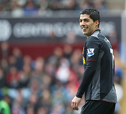 BIRMINGHAM, ENGLAND - Easter Sunday, March 31, 2013: Liverpool's Luis Alberto Suarez Diaz laughs as the assistant referee gives a decision against him during the Premiership match against Aston Villa at Villa Park. (Pic by David Rawcliffe/Propaganda)