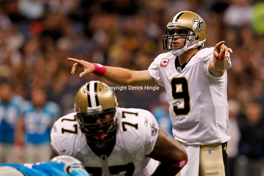 October 3, 2010; New Orleans, LA, USA; New Orleans Saints quarterback Drew Brees (9) point out from the line of scrimmage during the second quarter against the Carolina Panthers at the Louisiana Superdome. Mandatory Credit: Derick E. Hingle