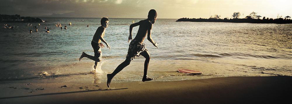Boys running on the beach, Le Gosier, Guadeloupe.