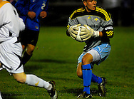 19 NOV. 2020 -- FENTON, Mo. -- St. Louis University High School soccer goalie Andrew Evola  looks to advance the ball after making a stop against St. John Vianney High School during the MSHSA Class 3 state soccer semifinal at the A-B Center in Fenton, Mo. Friday, Nov. 19, 2010. Vianney topped SLUH 2-0 to advance to the state title game on Saturday. Image © copyright 2010 Sid Hastings.