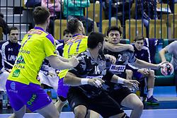 Luka Zvizej #77 of RK Celje Pivovarna Lasko and Omer Mercan #2 of Besiktas during handball match between RK Celje Pivovarna Lasko (SLO) and Besiktas J.K. (TUR)  in 14th Round of EHF Men's Champions League 2015/16, on March 5, 2016 in Arena Zlatorog, Celje, Slovenia. (Photo by Ziga Zupan / Sportida)