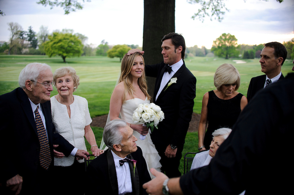 photo by Matt Roth.Saturday, April 14, 2012.Assignment ID: 30124225A..Molly Spencer Palmer and Lee Cowan, middle, have a moment, in between family portraits at their reception held at the Chevy Chase Club in Washington D.C. Saturday, April 14, 2012...Molly Palmer, 29, and Lee Cowan, 46, were colleagues at NBC News, but it wasn't until The Balloon Boy story coverage in 2009 that their romance sparked.