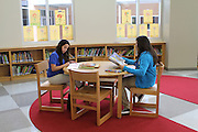 Students at Billy Reagan K-8 utilize one of the many tables in the library.