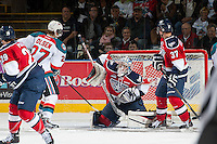 KELOWNA, CANADA - MARCH 23: Eric Comrie #1 of the Tri-City Americans makes a save against the Kelowna Rockets on March 23, 2014 during game 2 of the first round of WHL Playoffs at Prospera Place in Kelowna, British Columbia, Canada.   (Photo by Marissa Baecker/Getty Images)  *** Local Caption *** Eric Comrie;