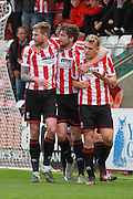 Danny Wright scores and celebrates  during the Vanarama National League match between Cheltenham Town and Lincoln City at Whaddon Road, Cheltenham, England on 30 April 2016. Photo by Antony Thompson.