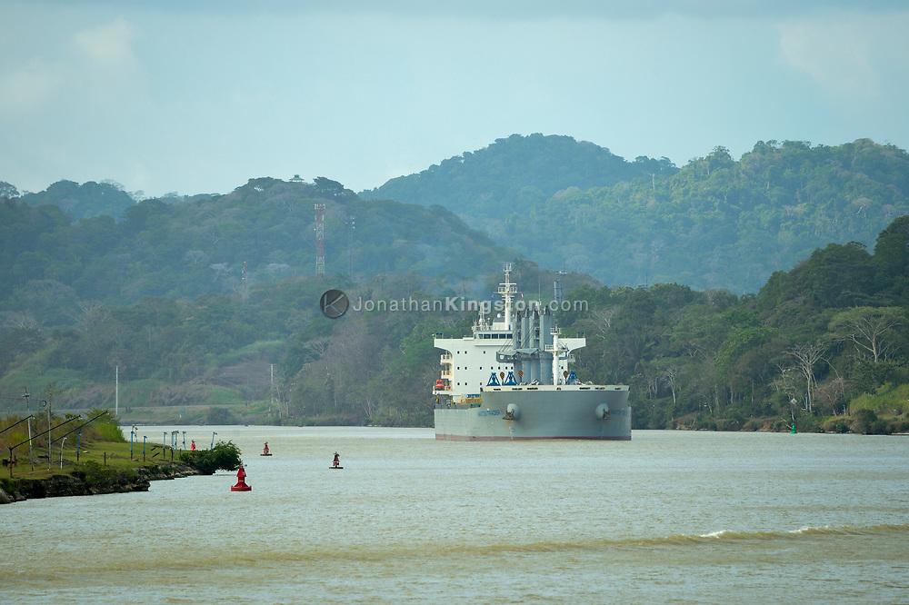 A large cargo ship transiting the Panama Canal, Panama.