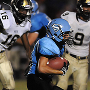 South Brunswick High School's Jacob Ashley lrushes against North Brunswick's Anthony Walker, left and Miquel Cano Friday September 13, 2013 at South Brunswick High School. (Jason A. Frizzelle)