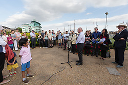 © Licensed to London News Pictures. 16/06/2017. LONDON, UK.  John Biggs, Mayor of Tower Hamlets speaking at The Great Get Together. Neighbours and friends of Jo Cox attend The Great Get Together near Hermitage Moorings in Wapping to pay tribute and celebrate Jo's call that more unites us than divides us on the anniversary of her death. Jo Cox lived on a house boat in Wapping with her husband Brendan Cox and two children. Photo credit: Vickie Flores/LNP
