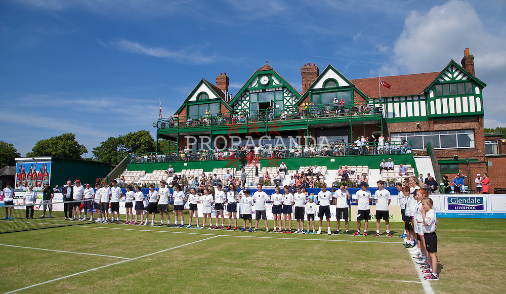 LIVERPOOL, ENGLAND - Sunday, June 22, 2014: Ball girls and boys during Day Four of the Liverpool Hope University International Tennis Tournament at Liverpool Cricket Club. (Pic by David Rawcliffe/Propaganda)