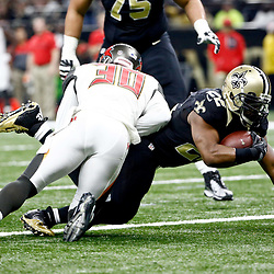 Dec 24, 2016; New Orleans, LA, USA; New Orleans Saints running back Mark Ingram (22) is tackled by Tampa Bay Buccaneers free safety Bradley McDougald (30) during the first quarter of a game at the Mercedes-Benz Superdome. Mandatory Credit: Derick E. Hingle-USA TODAY Sports