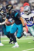 ARLINGTON, TX - OCTOBER 14:  Blake Bortles #5 of the Jacksonville Jaguars tries to out run the pressure from Jaylon Smith #54 of the Dallas Cowboys at AT&T Stadium on October 14, 2018 in Arlington, Texas.  The Cowboys defeated the Jaguars 40-7.  (Photo by Wesley Hitt/Getty Images) *** Local Caption *** Blake Bortles; Jaylon Smith