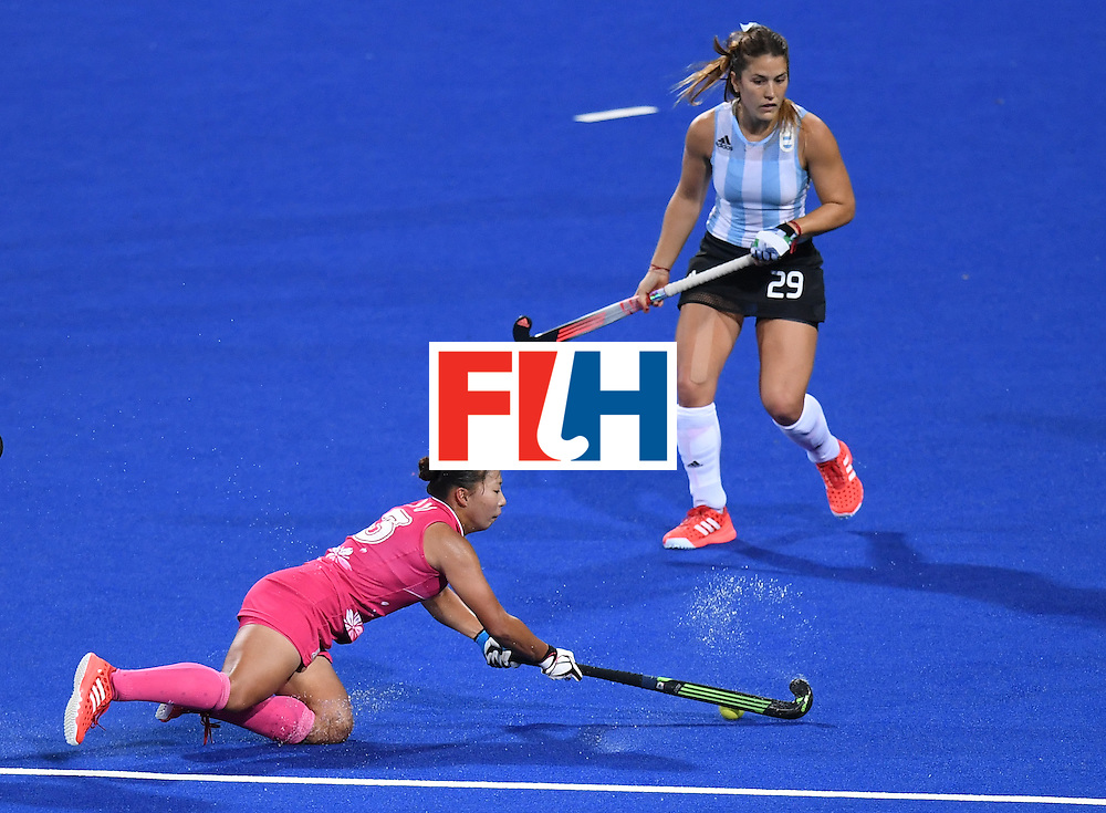 Japan's Yukari Mano dives for the ball as Argentina's Julia Gomes looks on during the women's field hockey Argentina vs Japan match of the Rio 2016 Olympics Games at the Olympic Hockey Centre in Rio de Janeiro on August, 8 2016. / AFP / MANAN VATSYAYANA        (Photo credit should read MANAN VATSYAYANA/AFP/Getty Images)