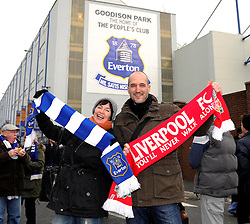 A Liverpool fc fan and Everton fc fan stand outside Goodison Park - Photo mandatory by-line: Dougie Allward/JMP - Tel: Mobile: 07966 386802 23/11/2013 - SPORT - Football - Liverpool - Merseyside derby - Goodison Park - Everton v Liverpool - Barclays Premier League