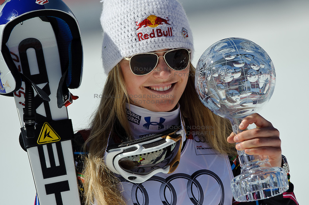 15-03-2012 SKIEN: FIS WORLD CUP 2012: SCHLADMING<br /> Lindsey Vonn of USA Worldcup Champion of Downhill Worldcup with downhill crystal globe during Downhill Worldcup winner ceremony of FIS Ski Alpine World Cup at Planai Stadium in Schladming<br /> **NETHERLANDS ONLY** <br /> ©2012-FotoHoogendoorn.nl/EXPA/Sandro Zangrando