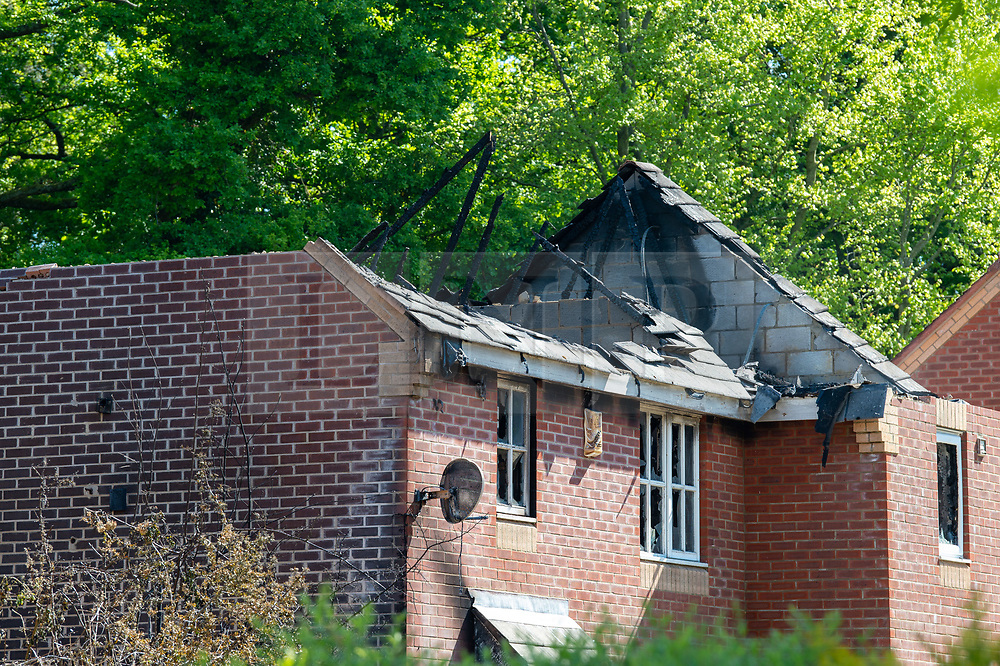 © Licensed to London News Pictures. 06/05/2020. Woolton Hill, UK. The burnt out roof of one of the two houses destroyed by an overnight fire. A fire has destroyed two houses on Woolton Lodge Gardens, Woolton Hill in Hampshire. The fire started approximately 20:10 BST on Tuesday 05/05/2020. Photo credit: Peter Manning/LNP