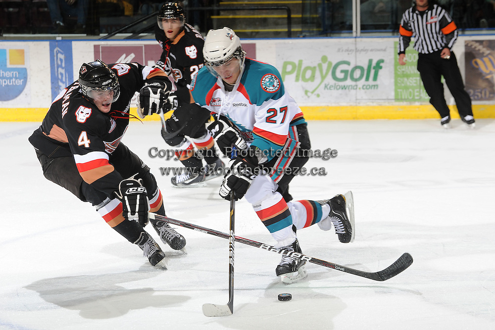 KELOWNA, CANADA, FEBRUARY 17: Jessey Astles #27 of the Kelowna Rockets is checked by Peter Kosterman #4 of the Calgary Hitmen at the Kelowna Rockets on February 17, 2012 at Prospera Place in Kelowna, British Columbia, Canada (Photo by Marissa Baecker/Shoot the Breeze) *** Local Caption ***